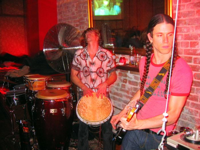 J. Bowman (on guitar) & Drumfire (on percussion) from the Late Night Sneaky band (@ Dragon Bar, 01/29/04)
