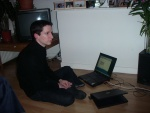 Alexi relaxing (with two laptops...).JPG