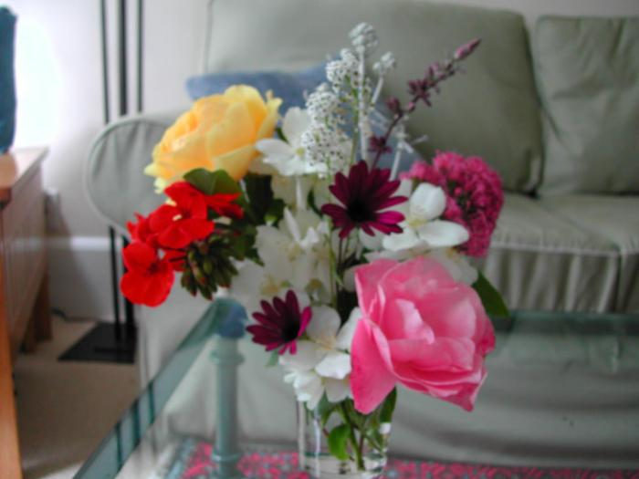 I made this bouquet for you with flowers from my yard.  I hope you like them.