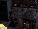 Frank tending the fire